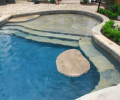 Stone clad tanning shelf with table & underwater bench