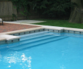 Custom slate design; Indiana limestone coping; Laguna blue marbelite