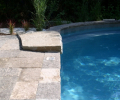 Diving rock; Wiarton stone coping & decking; Charcoal grey marbelite