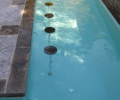 Underwater stools; Patterned concrete deck; Wiarton coping; White marbelite